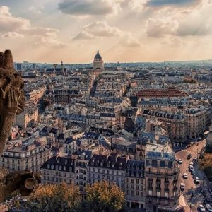 Gargoyle and bird's eye view of Paris France